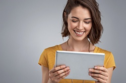 Woman looking at insurance forms on tablet computer