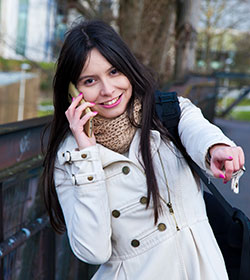 woman pointing while on phone