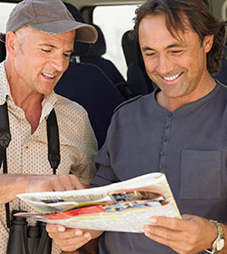 two men looking at magazine