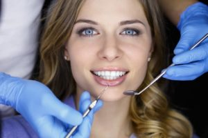 Woman smiling in dentist's chair.