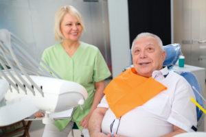 older man sitting in dentist chair